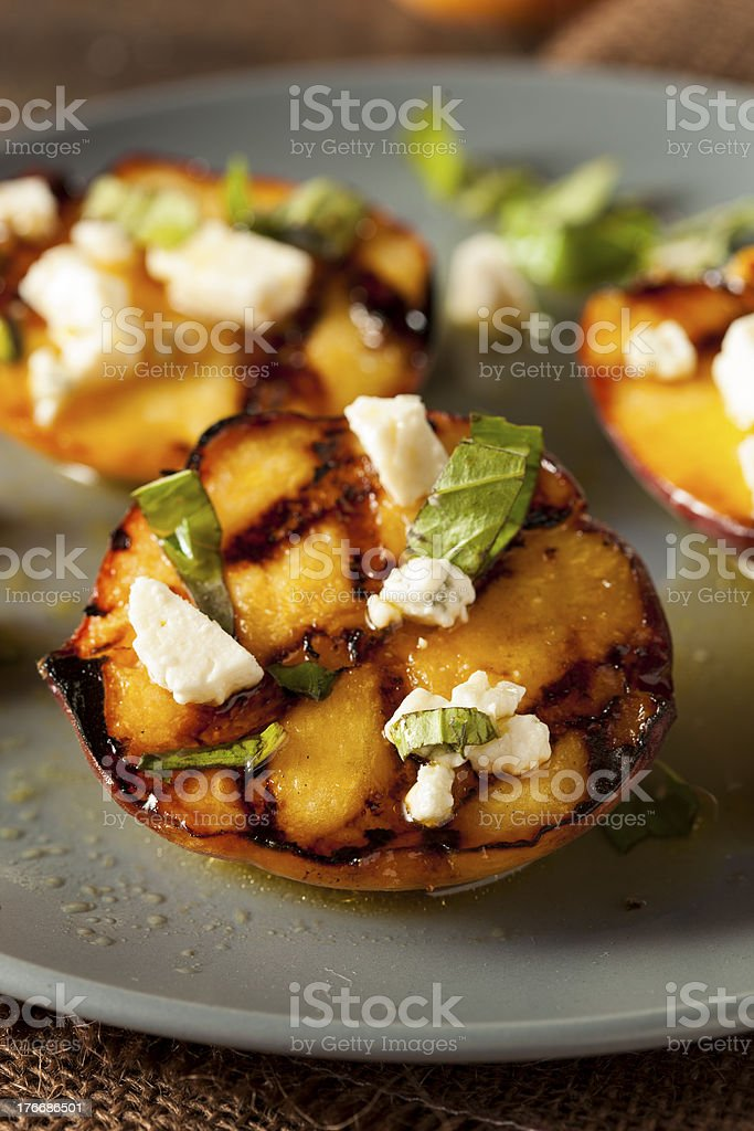 Gourmet Roasted Peaches with cheese and basil royalty-free stock photo