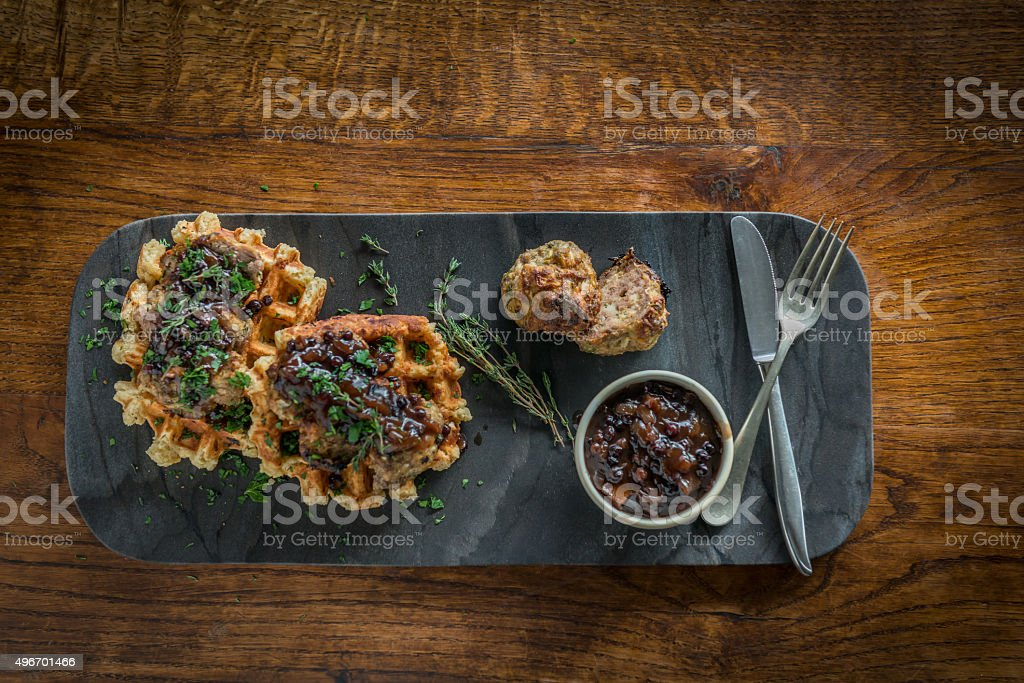 Gourmet Savoury Belgian Waffles, Meatballs, Onion Gravy on Slate Plate stock photo