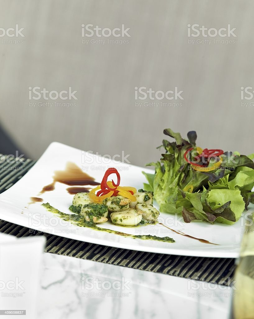 Gourmet Scallop with Pesto Sauce royalty-free stock photo
