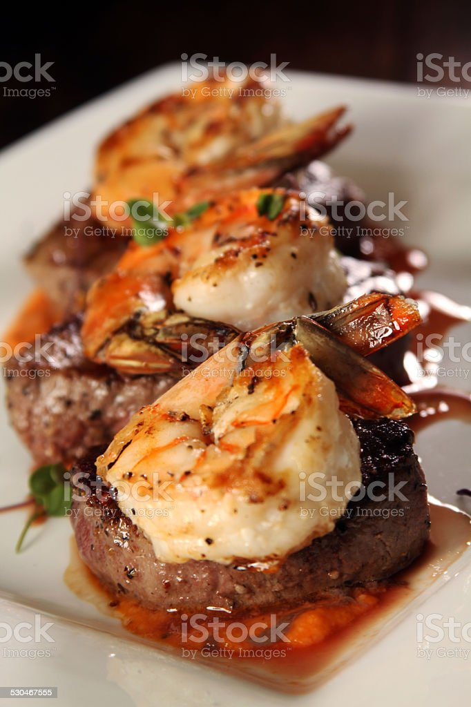 Gourmet shrimp and steak close stock photo