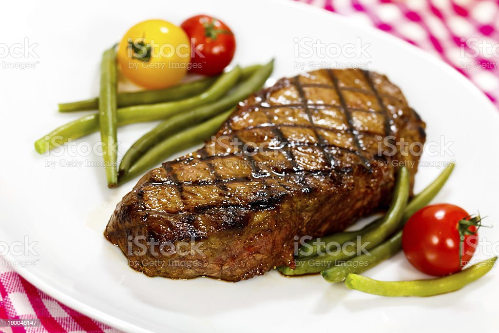 Gourmet Steak with Green Beans,Cherry Tomato stock photo