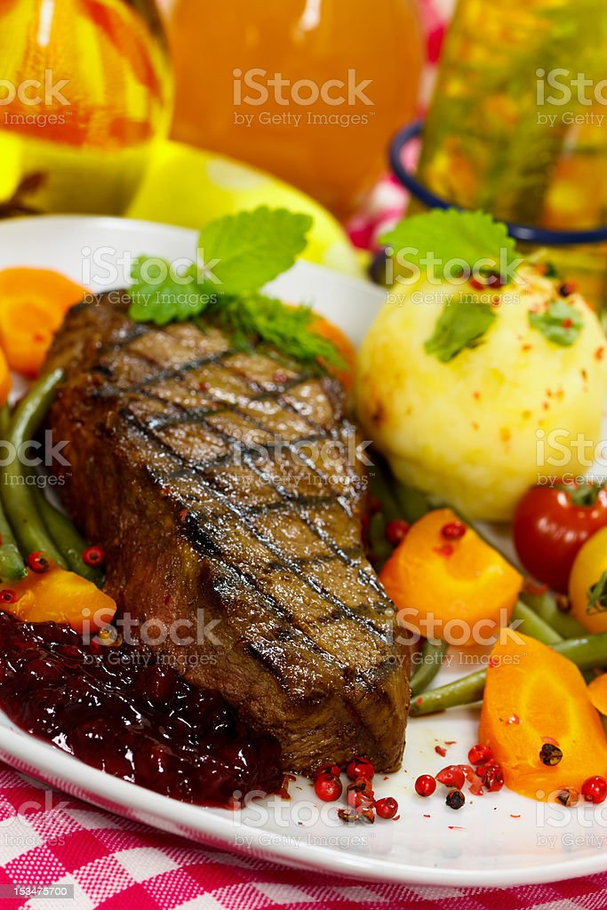 Gourmet Steak with Green Beans,Cherry Tomato,Cranberry royalty-free stock photo