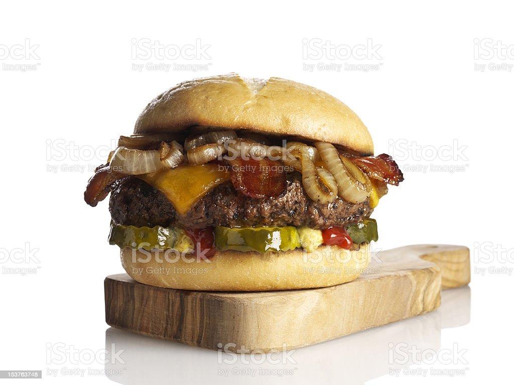 Estilo Gourmet Cheesebúrguer com bacon. foto royalty-free