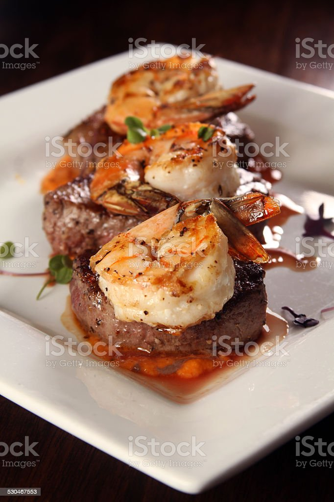 Gourmet surf and turf with shrimp and steak stock photo