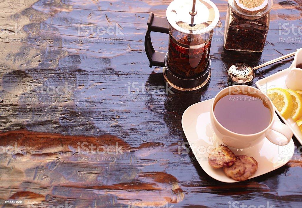 Gourmet tea set with scones and orange slices royalty-free stock photo