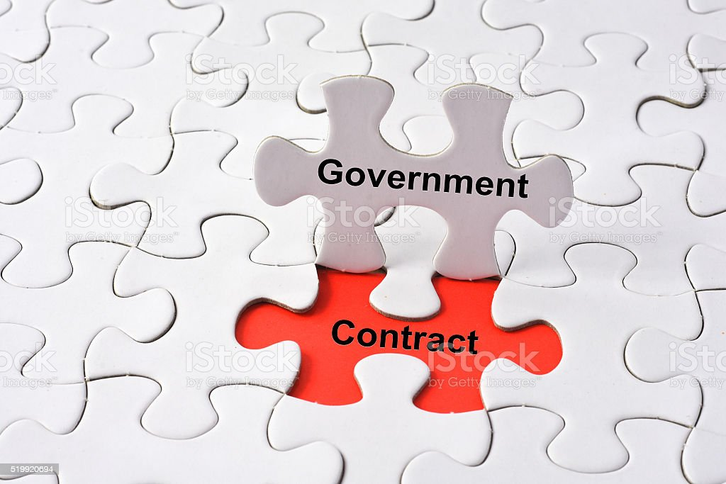 Government contract concept on missing puzzle stock photo