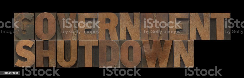 government shutdown in old wood type stock photo