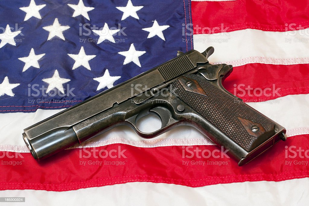 Govt Issue 1911 On US Flag stock photo