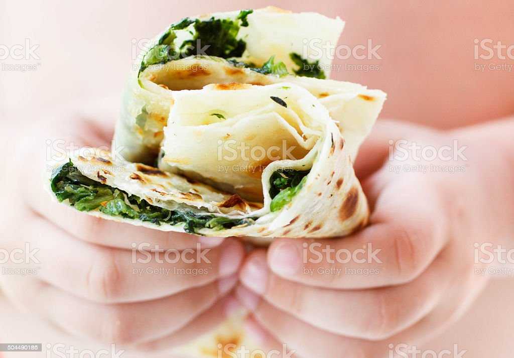 Gozleme. Turkish flatbread with greens. Shallow depth of field stock photo