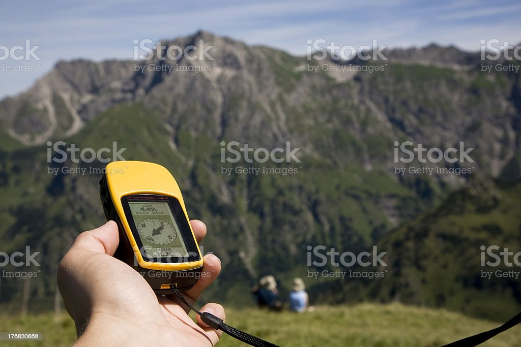 gps and two people in the alps stock photo