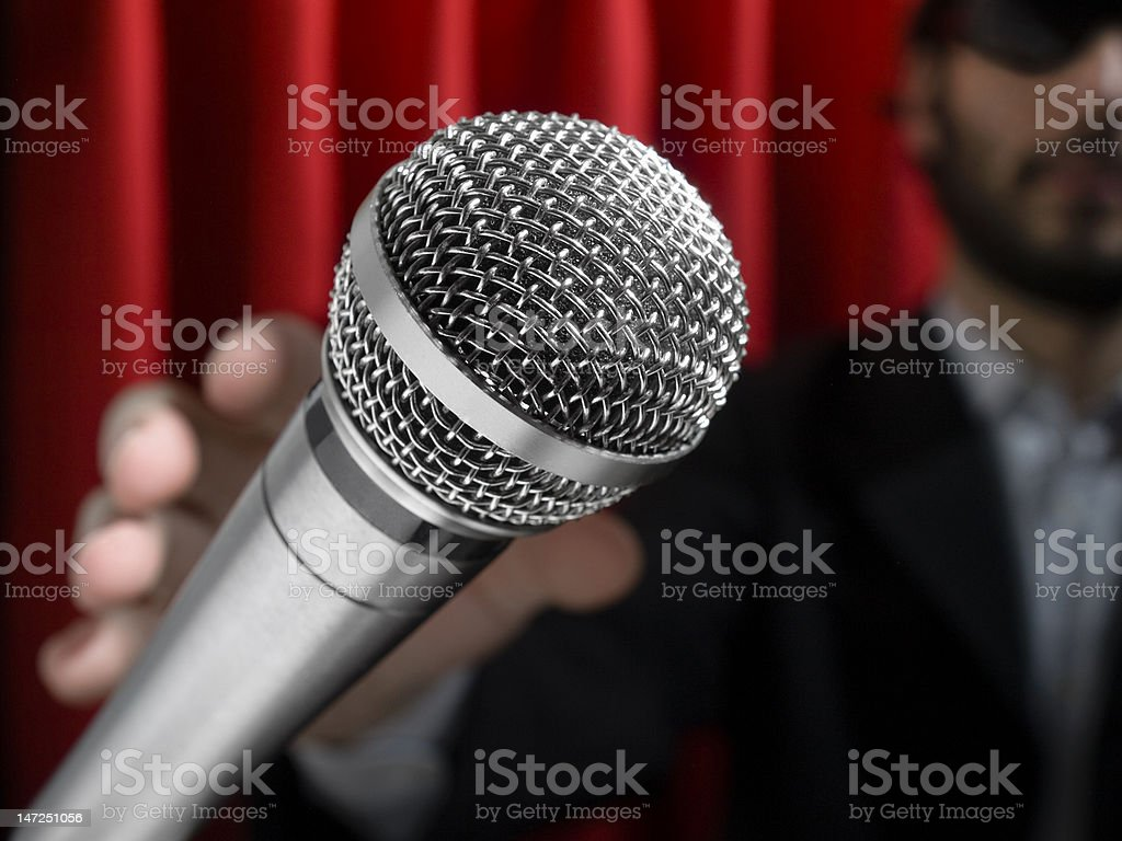 Grab the mic royalty-free stock photo
