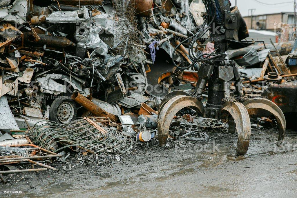 Grabber picking trash up at dump with scarp metal stock photo