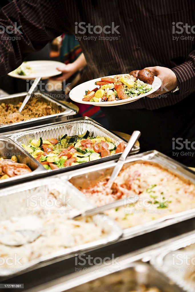 grabbing a plate of food royalty-free stock photo