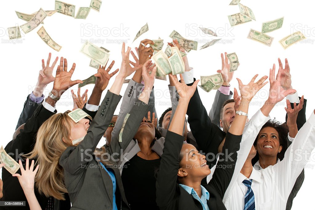 Grabbing for Cash like Winning the Lottery stock photo