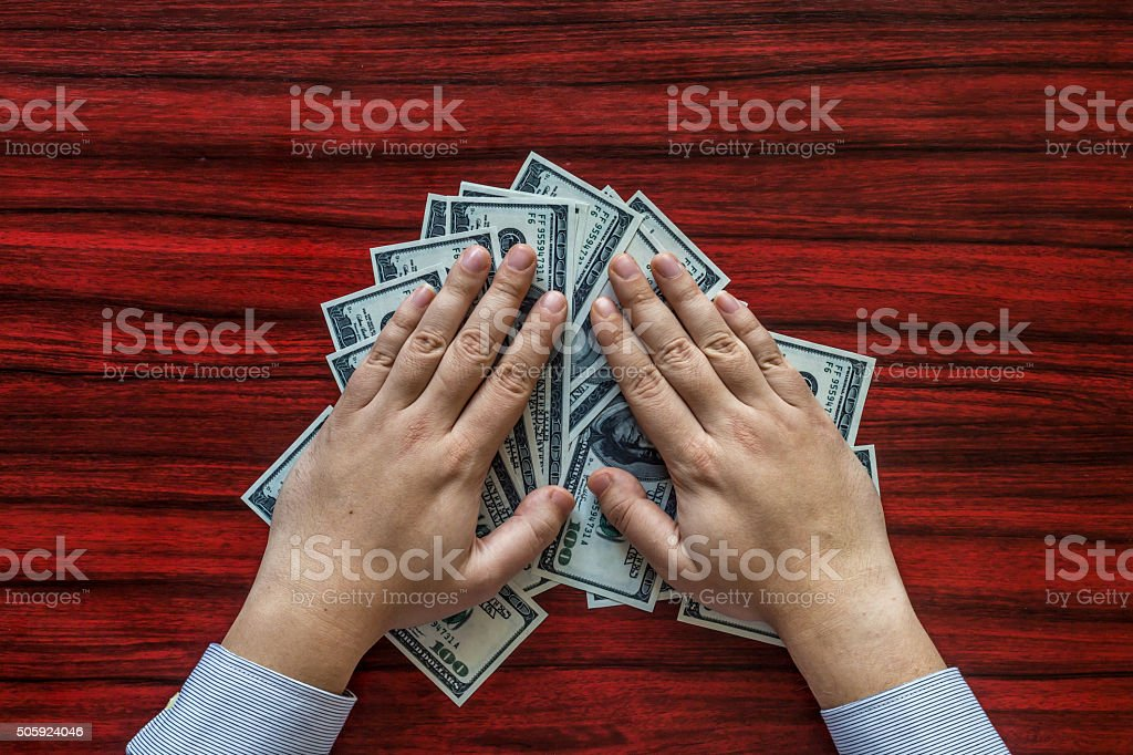 Grabbing money stock photo