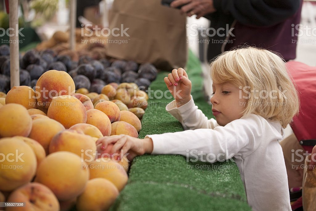 grabbing peaches royalty-free stock photo