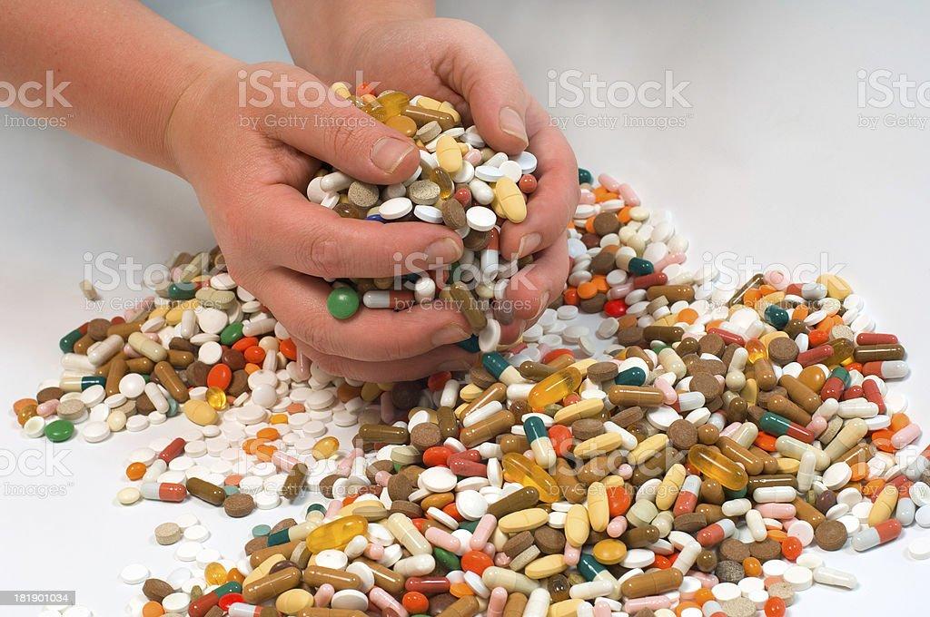 grabbing pills stock photo