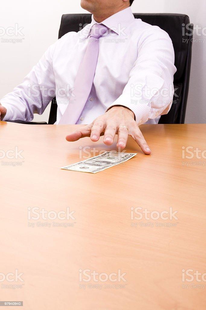 Grabbing the dollar bill stock photo