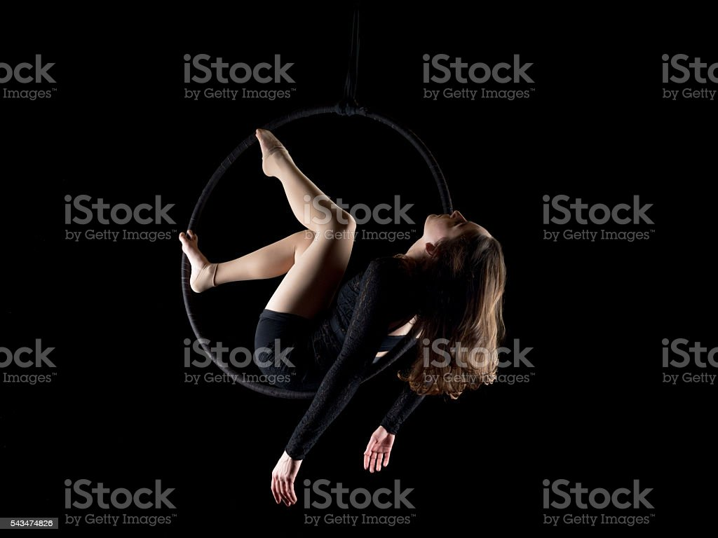 Graceful aerial dancer woman isolated on black stock photo