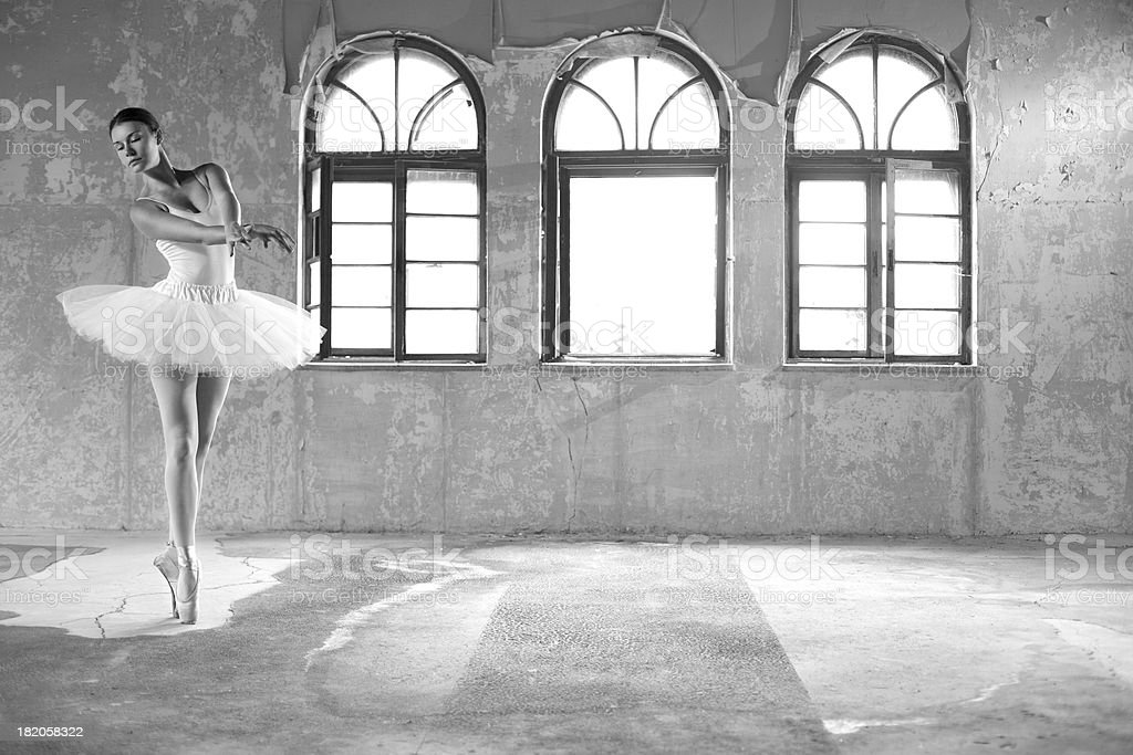 Graceful ballerina dancing stock photo