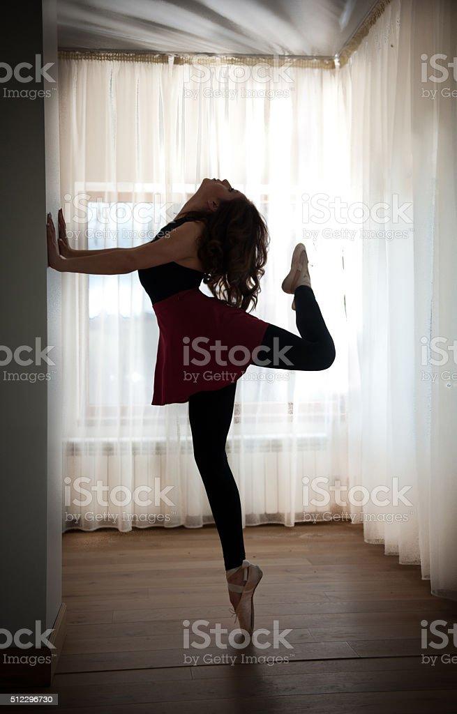 Graceful ballerina silhouette in ballet pose stock photo