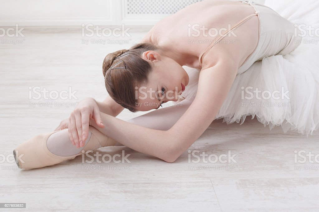 Graceful Ballerina stretching, ballet background stock photo