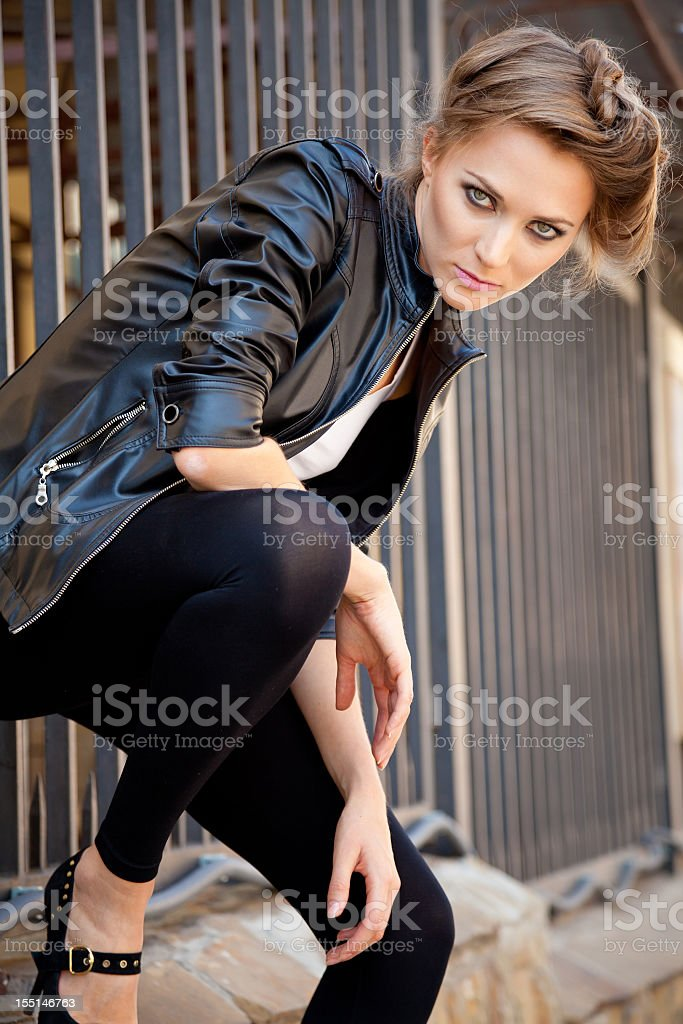 Graceful young woman with beautiful bottomless eyes posing aggressively outdoors royalty-free stock photo