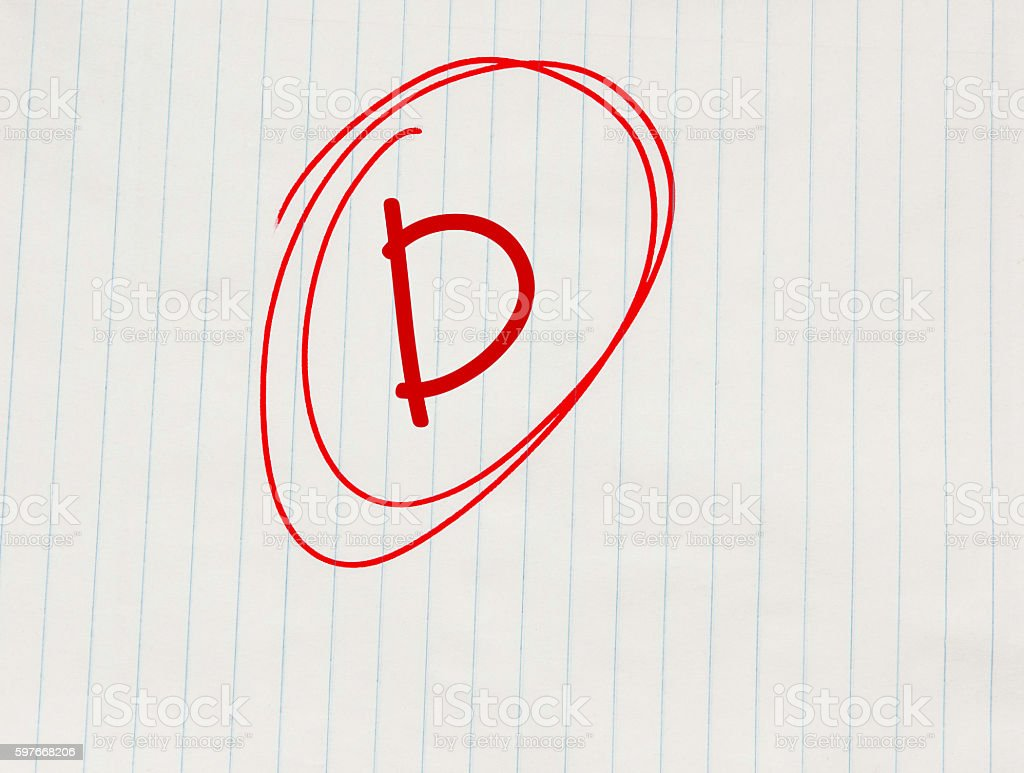 D grade written in red on notebook paper stock photo