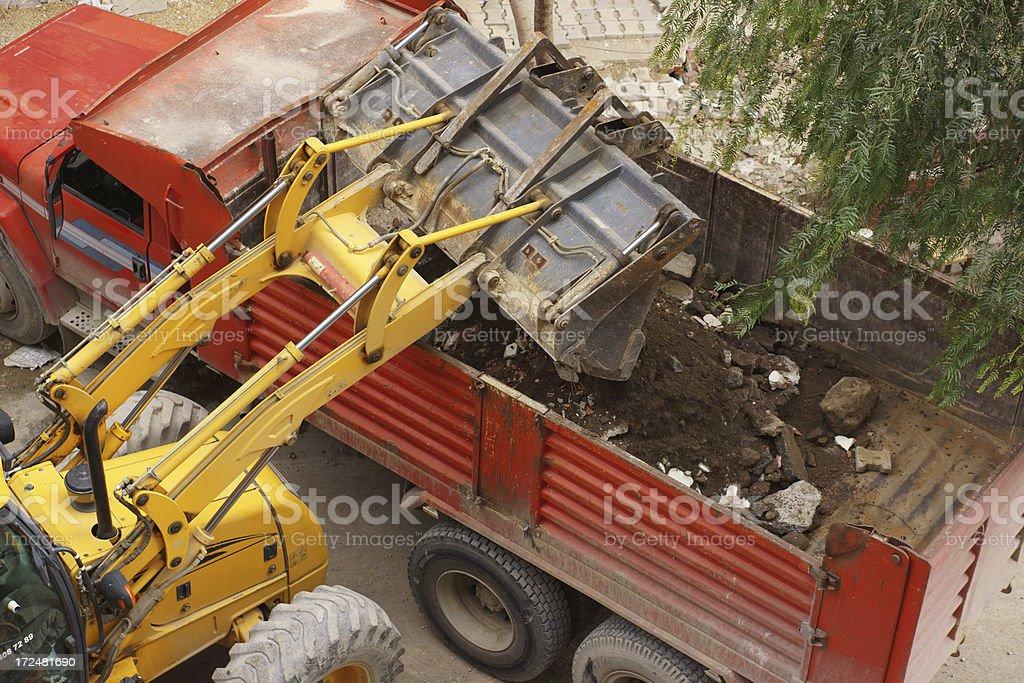 Grader loading dumper truck royalty-free stock photo