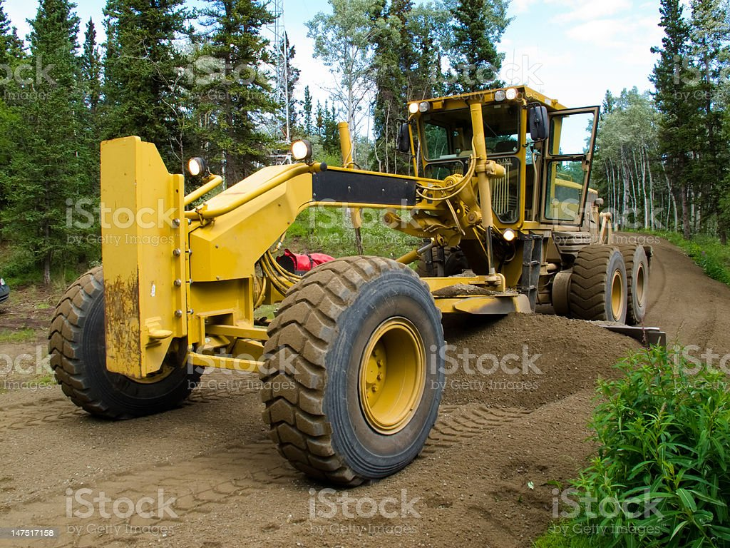 Grader resurfacing narrow rural road stock photo