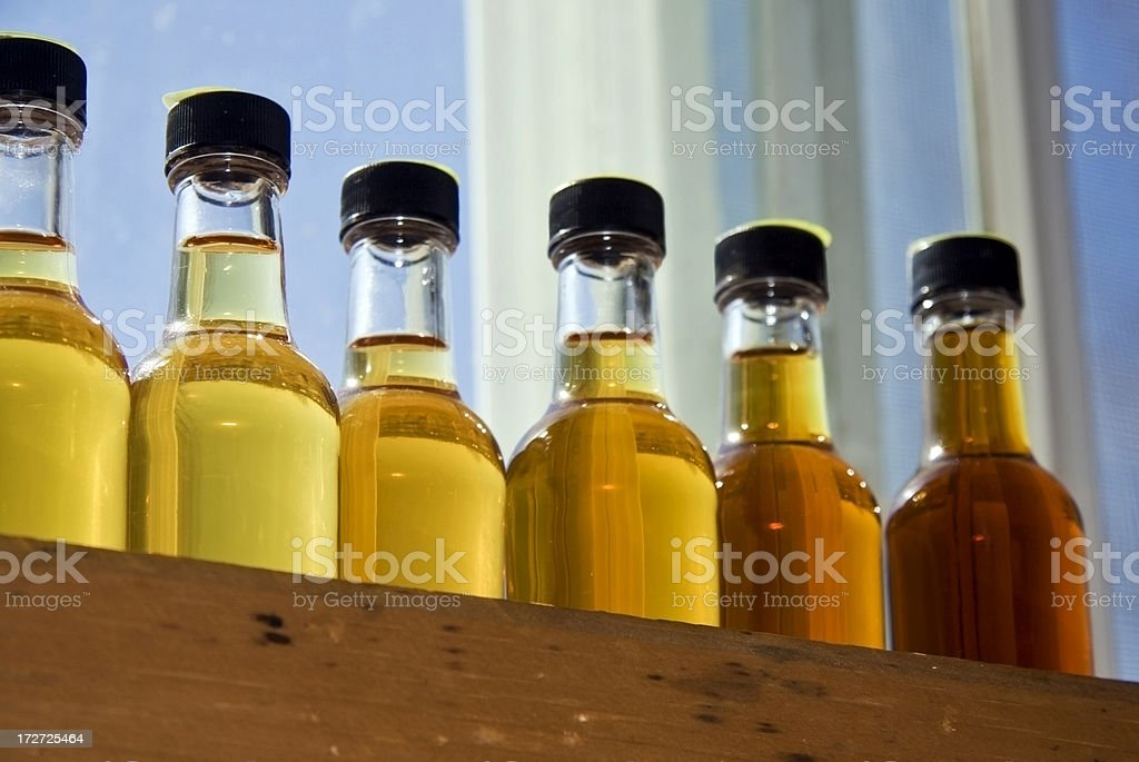 Grades of maple syrup in small bottles royalty-free stock photo