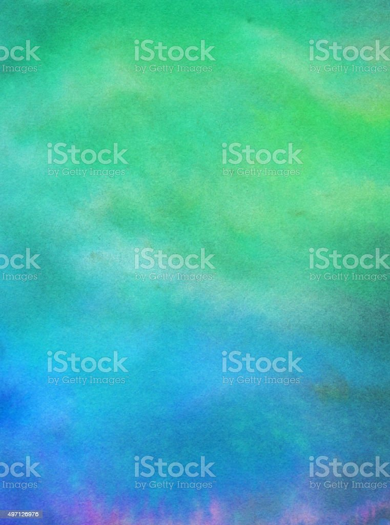 Gradient of blue and green colors hand painted on paper stock photo