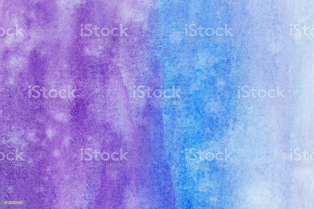 Gradient of purple and blue hues hand painted on paper stock photo