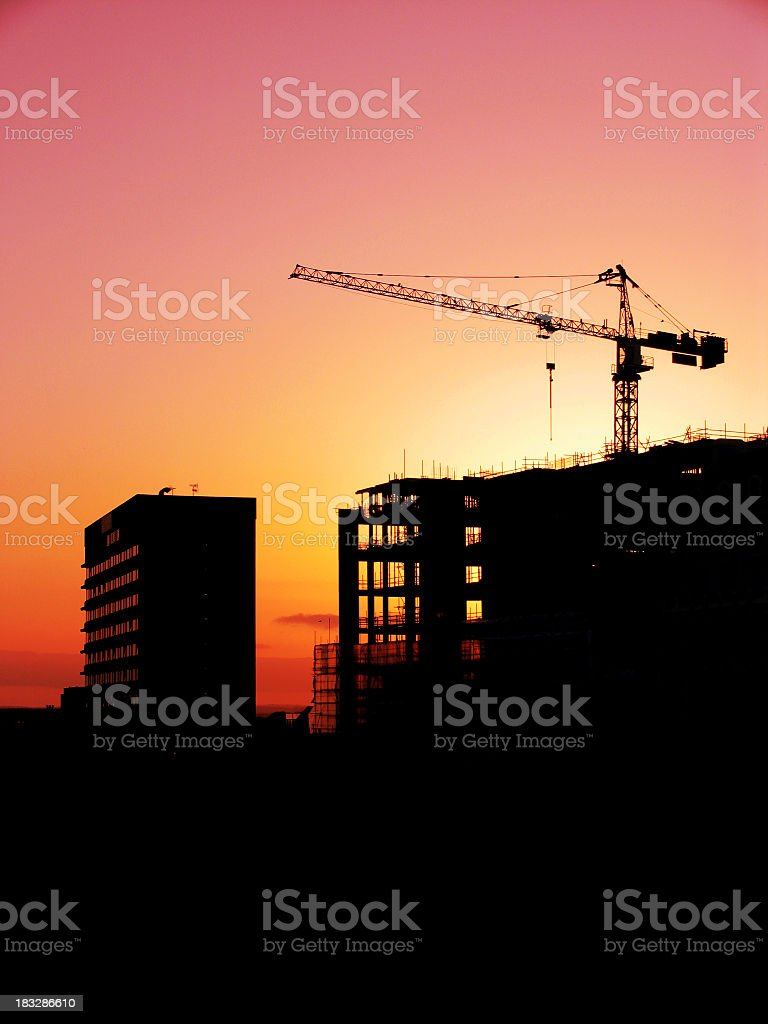 Gradient Sunset Behind a Black Construction Site royalty-free stock photo