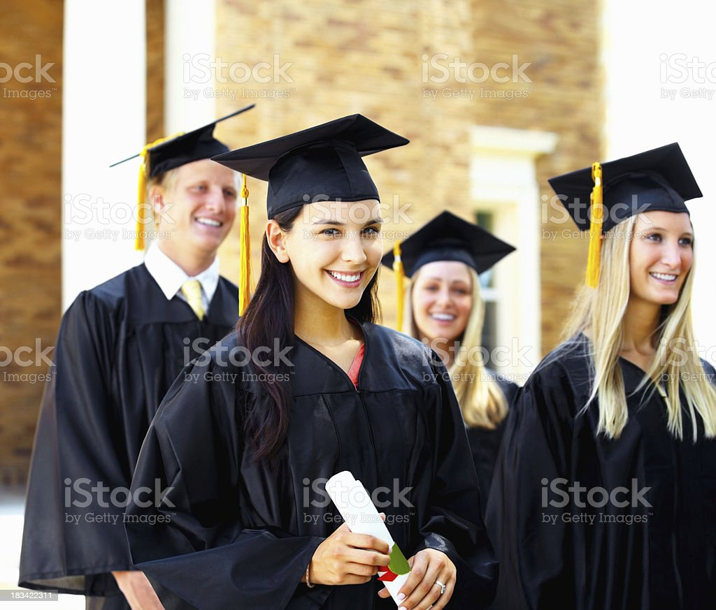 Graduate girl in gown with diploma royalty-free stock photo