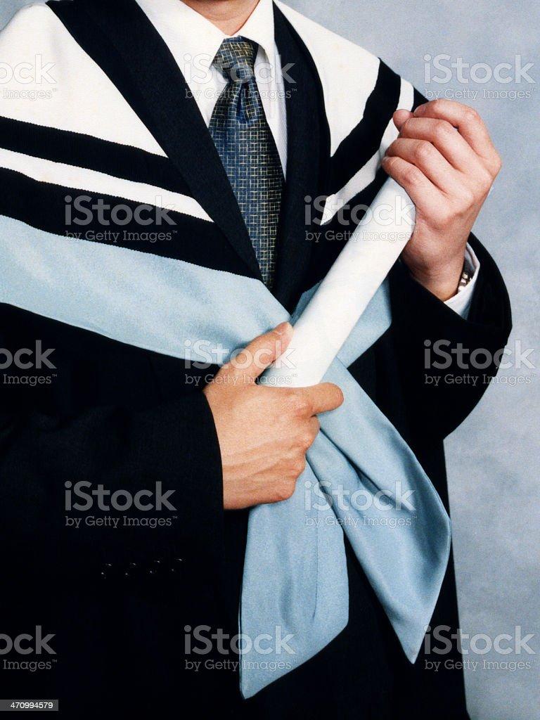 Graduate Holding Scroll royalty-free stock photo