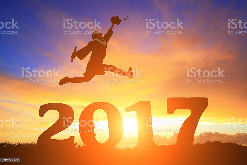 graduate student jump over 2017 stock photo