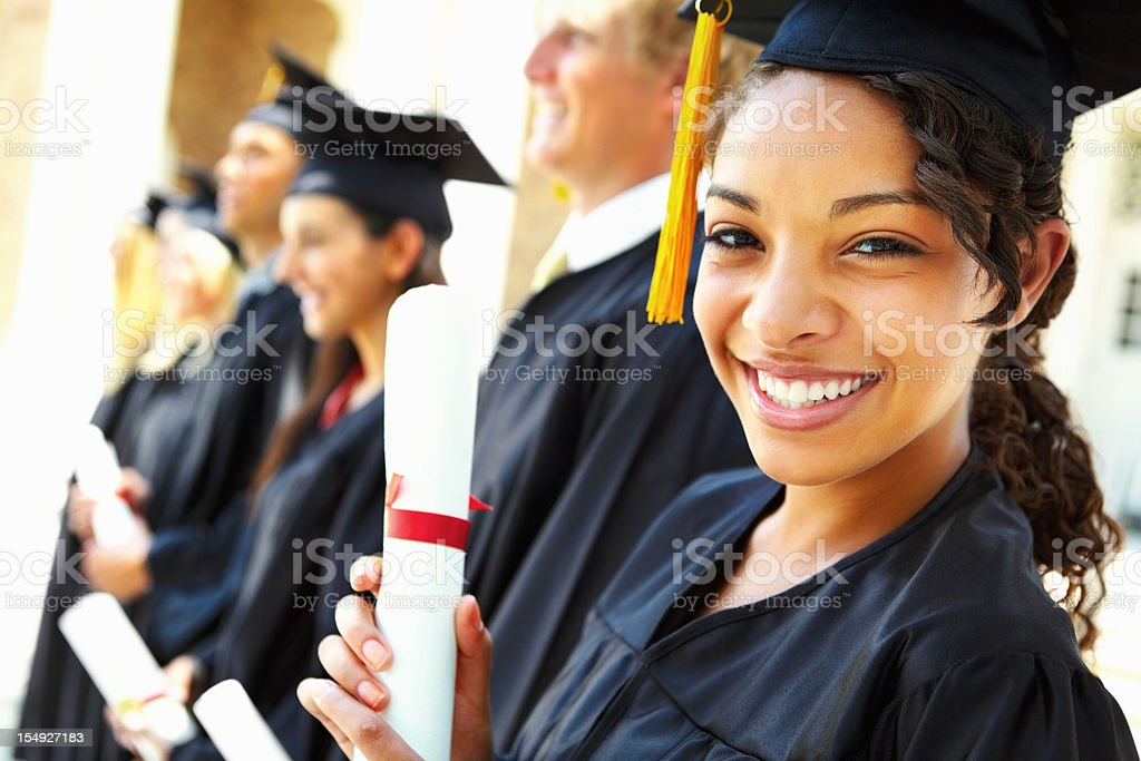 Graduate students standing together in a row stock photo