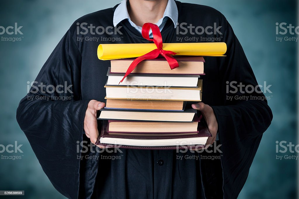 graduate with books and diploma stock photo
