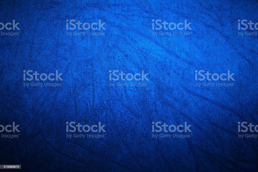 Graduated blue fabric background stock photo
