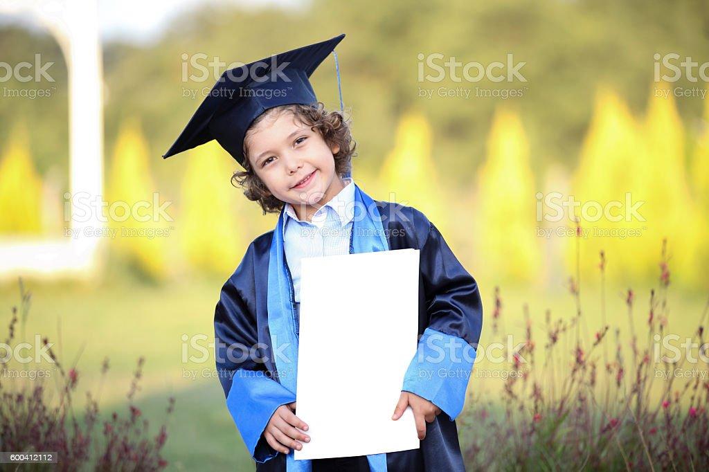 Graduated boy stock photo