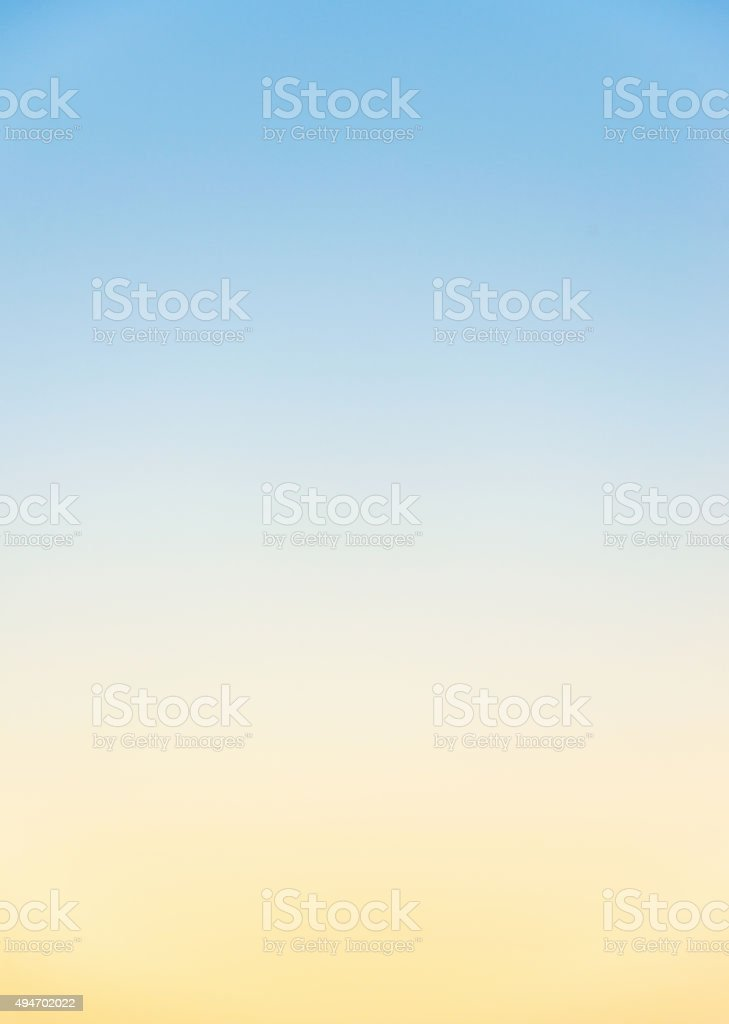 Graduated clear sky colours at sunset stock photo
