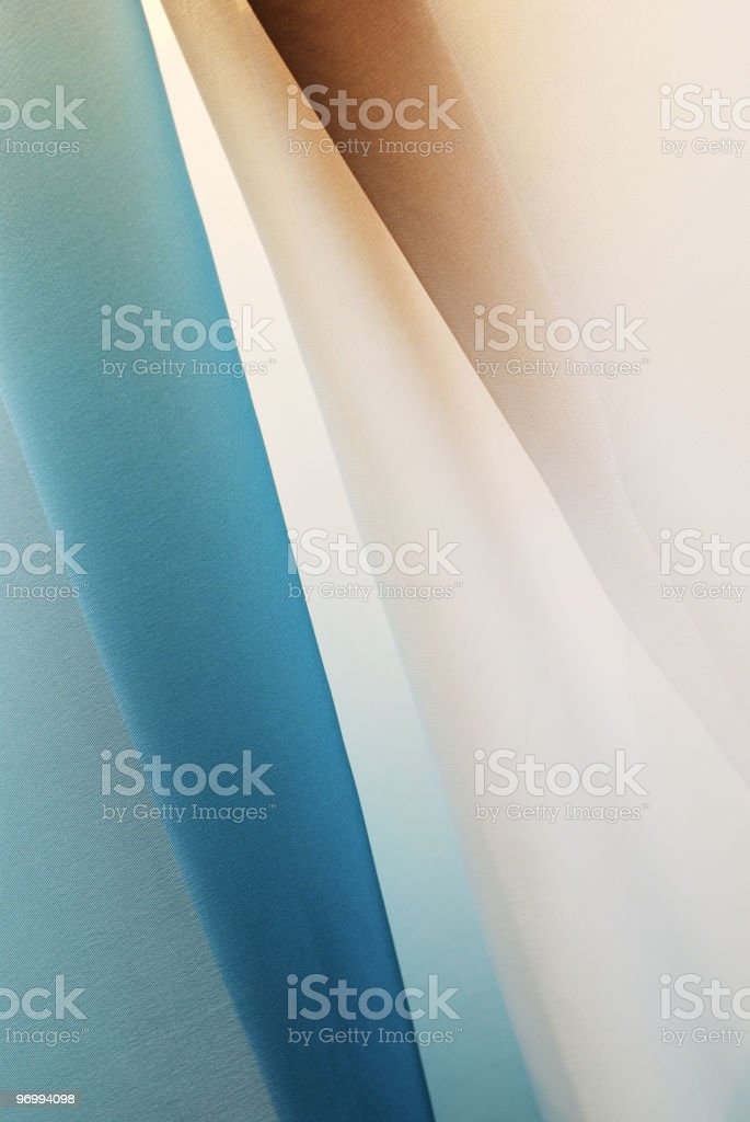 Graduated silk from blue to white and brown stock photo