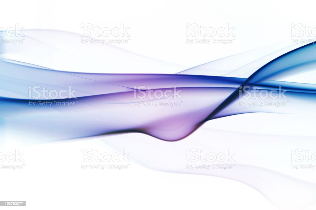 Graduated silky smoke from blue to purple stock photo