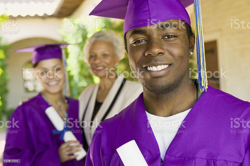 Graduates and Grandmother stock photo