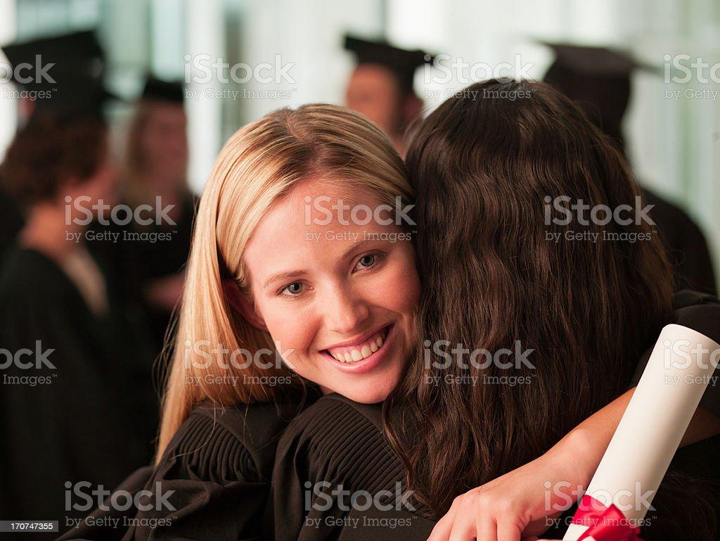 Graduates hugging royalty-free stock photo
