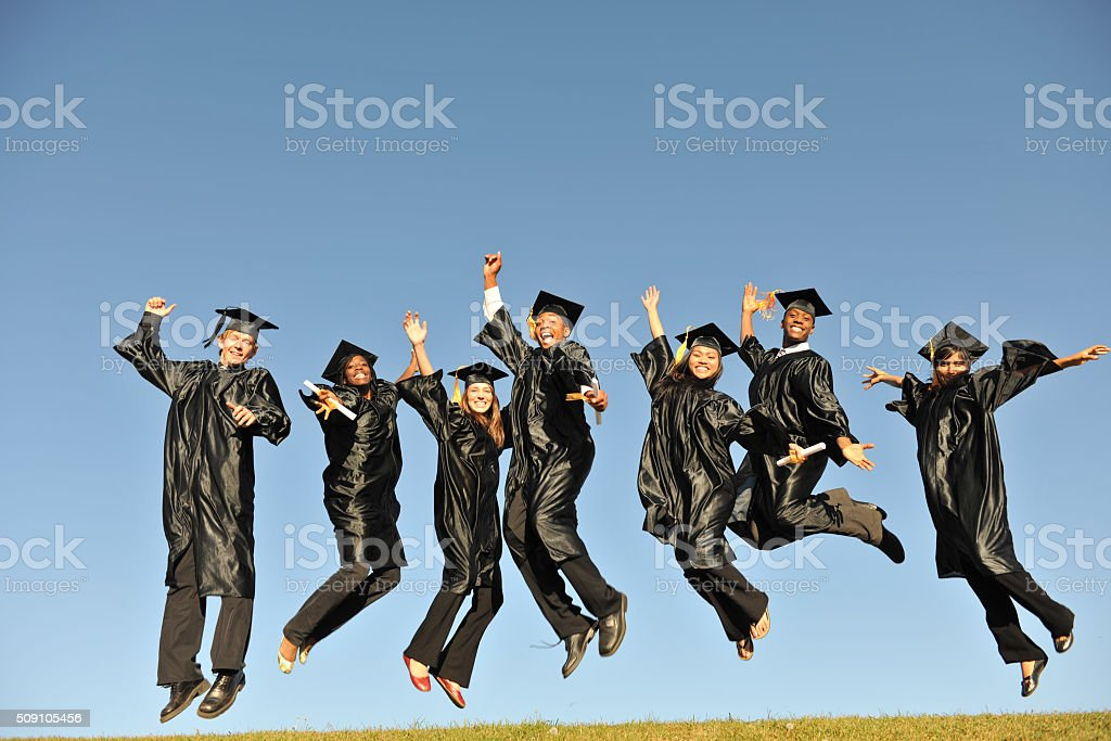 Graduates Jumping in the Air stock photo