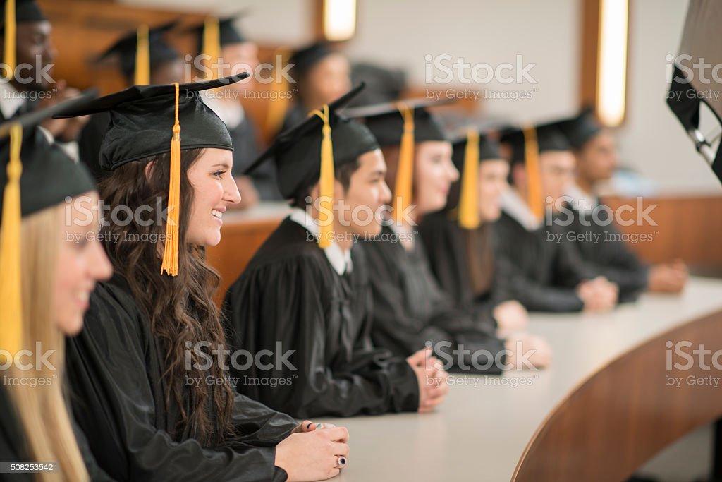 Graduates Listening to a Speech stock photo