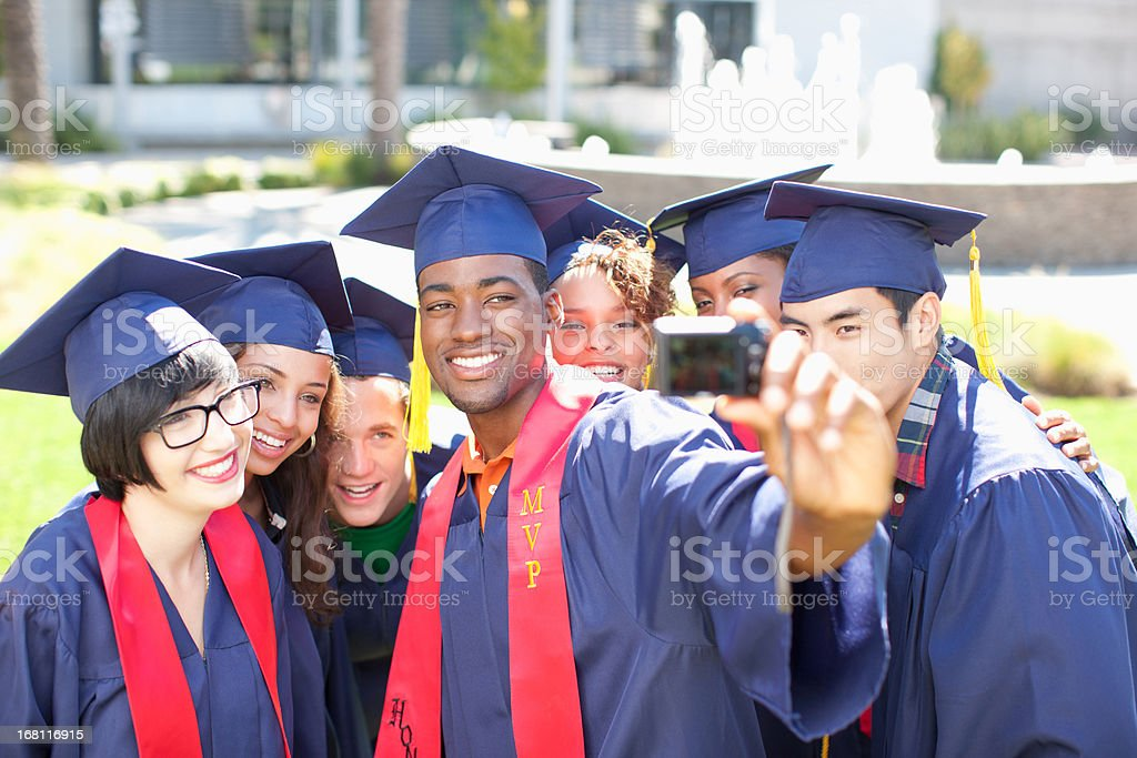 Graduates taking picture of themselves royalty-free stock photo