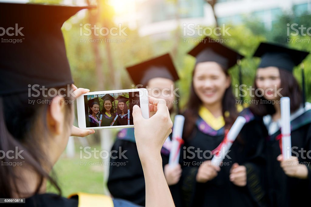 Graduates taking picture stock photo